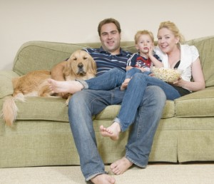 Young family on couch after upholstery cleaning